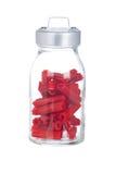 Alcaçuz vermelho no frasco de vidro Fotografia de Stock