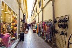 Alcaiceria Market in Granada, Spain. Narrow streets filled with Stock Photo