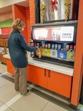 People serving carbonated drinks in the burger king. royalty free stock photos