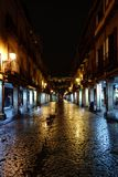 Alcala de Henares, Madrid, Spain. November 28, 2017: Main street. Of the town called `Mayor` with ancient stone arcades and Christmas illumination turned off on Stock Photos
