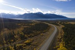 Alcan Highway near Kluane Lake. Aerial view of the Alaska Highway leading towards Kluane Lake in the Yukon in Canada on a sunny day during the Indian Summer royalty free stock images
