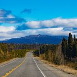 Alcan thru great Yukon Territory outdoors Canada. Alaska Highway Alcan in great empty nature wilderness landscape of Southern Yukon Territory, YT, Canada stock images
