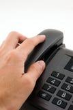 Alcance de la mano para el teléfono Fotos de archivo