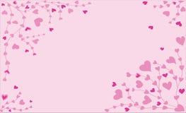 Alcance de ramificaciones con los pequeños corazones rosados Fotografía de archivo libre de regalías