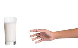 Alcance para um vidro do leite II Fotografia de Stock