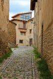 Alcaniz, Aragon, Spain. Narrow cobblestone street in Alcaniz, Aragon, Spain stock images