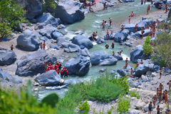 ALCANTARA, ITALY - AUGUST, 2015: People enjoy ice-cold water of Alcantara river in the Alcantara river park in August, 2015 in Sic Stock Photography