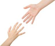 Alcanzar las manos Imagen de archivo libre de regalías