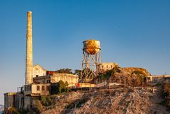 Alcatraz Chimney and Water Tower in the evening light - colour version stock photo