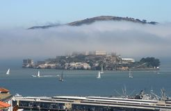 Alcatraz in Fog. Alcatraz prison sits shrowded in fog in San Francisco Bay stock photography