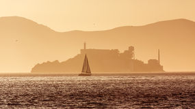 Alcatraz island penitentiary at sunset backlight in san Francisc Royalty Free Stock Image
