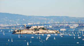 Alcatraz Island and Prison in San Francisco Bay. On a sunny and hazy day with many boats around Royalty Free Stock Photography