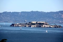 Alcatraz Island in San Francisco Bay with boats, ships in background, California, USA Royalty Free Stock Photography