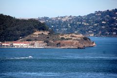 Alcatraz Island in San Francisco Bay with boats, ships in background, California, USA Royalty Free Stock Images