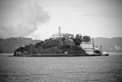 Alcatraz island in San Francisco, California. Black and white image of Alcatraz island in San Francisco, California looking over the bay Royalty Free Stock Photos