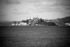 Alcatraz island in San Francisco, California. Black and white image of Alcatraz island in San Francisco, California looking over the bay Stock Images