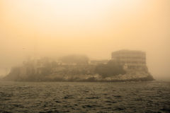 Alcatraz Island in San Francisco during the huge fog. Sepia toned Royalty Free Stock Image