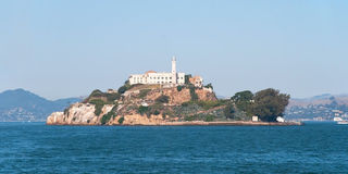 Alcatraz jail island in San Francisco bay with a beautiful blue Stock Images