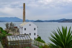 Alcatraz Penitentiary Chimney and nature. Photo of Alcatraz Island from the ground. Chimney, Alactraz sign and nature stock photography