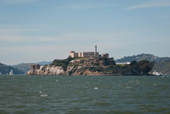 Alcatraz Prison. Scenic view of Alcatraz maximum security federal prison historical landmark seen from San Francisco bay shoreline on a clear sunny day stock photo