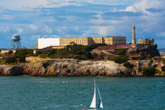 Alcatraz. San Francisco, CA, USA - May 21, 2016: Sail boat cruisng past Alcatraz Island in the San Francisco Bay Royalty Free Stock Image