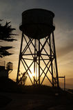 Alcatraz Water Tower Silhouette. The Sun setting behind the Alcatraz Water Tower in San Francisco Bay, California Stock Image