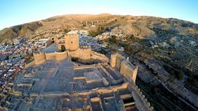 Defense Walls of Ancient fortress Alcazaba of Almeria, Spain - aerial shot including panoramic view of the Almeria city. Alcazaba, Aerial shot of an old muslim stock video footage