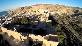 Defense Walls of Ancient fortress Alcazaba of Almeria, Spain - aerial shot including panoramic view of the Almeria city. Alcazaba, Aerial shot of an old muslim stock footage