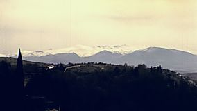 Alcazaba of Alhambra aerial view. Aerial view of surrounding mountains and panorama from the top of Alcazaba of the Alhambra of Granada. Unesco World Heritage stock video footage