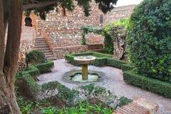 Alcazaba in Malaga. Alcazaba castle garden in Malaga, Spain. Small fountain stock photos