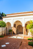 Alcazaba of Malaga in Andalusia, Spain. Typical muslim architecture with archs in a courtyard Royalty Free Stock Photo