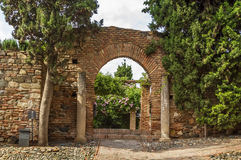 Alcazaba of Malaga, Spain. The Alcazaba is a palatial fortification in Malaga, Spain. Arch in the Garden Stock Photos