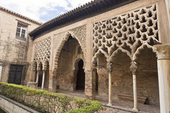 Alcazar Almohad Palace. The Almohad Palace seen from the Patio del Yeso in the Alcazar Royal of Seville, Spain stock images