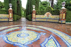 Alcazar gardens in Seville. Seville, Spain - Royal Alcazar gardens, famous UNESCO World Heritage Site. Moorish architecture Royalty Free Stock Photography