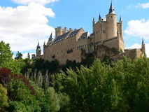 Alcazar, Segovia ( Spain ). View of the Alcazar of Segovia, a hot summer day Stock Photos