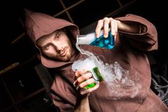 Alchemist in chemical laboratory prepares magical liquids Royalty Free Stock Photography