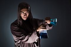 The alchemist doing experiments in alchemy concept. Alchemist doing experiments in alchemy concept Stock Photos
