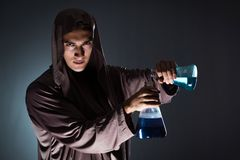 The alchemist doing experiments in alchemy concept. Alchemist doing experiments in alchemy concept Royalty Free Stock Photos