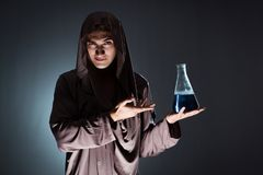 The alchemist doing experiments in alchemy concept. Alchemist doing experiments in alchemy concept Stock Image
