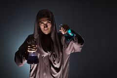 The alchemist doing experiments in alchemy concept. Alchemist doing experiments in alchemy concept Royalty Free Stock Images