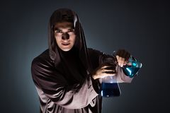 The alchemist doing experiments in alchemy concept. Alchemist doing experiments in alchemy concept Royalty Free Stock Photo