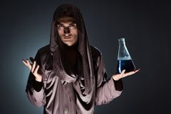 The alchemist doing experiments in alchemy concept. Alchemist doing experiments in alchemy concept Stock Photography