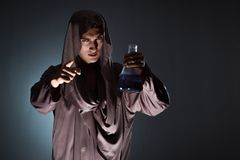 The alchemist doing experiments in alchemy concept. Alchemist doing experiments in alchemy concept Stock Images