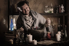 Alchemist at the table Stock Image