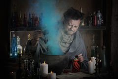 Alchemist at the table Royalty Free Stock Photos