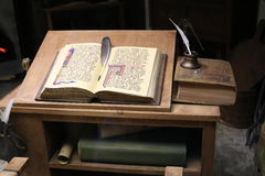 Alchemist table. With scrolls and with an open book Stock Photo