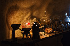 Alchemy. An old alchemist laboratory interior stock photo