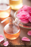 Alchemy and aromatherapy with pink flowers Stock Photography