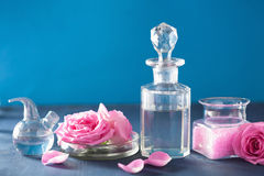 Alchemy and aromatherapy with rose flowers and chemical flasks Stock Photo