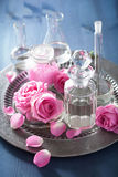 Alchemy and aromatherapy with rose flowers and chemical flasks Royalty Free Stock Photography